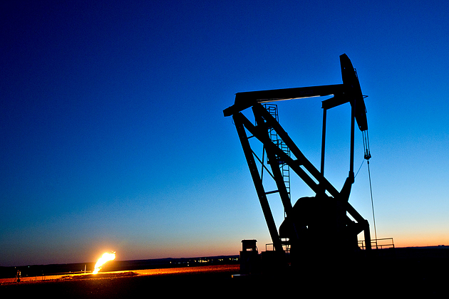 Crude oil being extracted from a well outside South Heart, North Dakota, on Feb. 10, 2012. Photograph by Daniel Acker