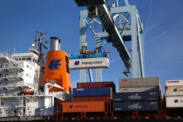 A Hapag-Lloyd shipping container is unloaded at the Port of Los Angeles in San Pedro, Calif., on April 8. Photograph by Patrick T. Fallon