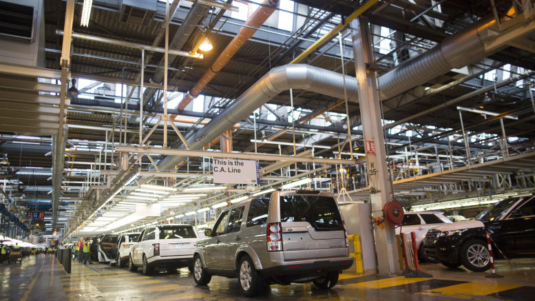 New Ranger Rover and Land Rover automobiles sit at the end of the assembly line at the Jaguar Land Rover Plc plant in Solihull, U.K., on Wednesday, July 24, 2013. Photographer: Simon Dawson/Bloomberg via Getty Images