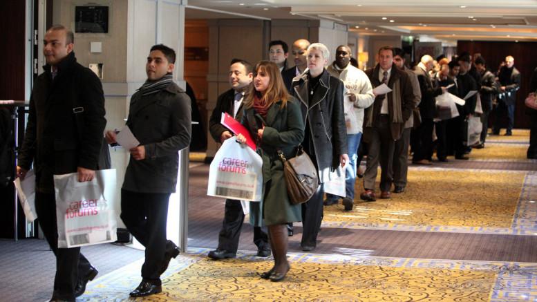 Jobseekers line up to attend a job fair in London, U.K. In September. Photographer: Chris Ratcliffe