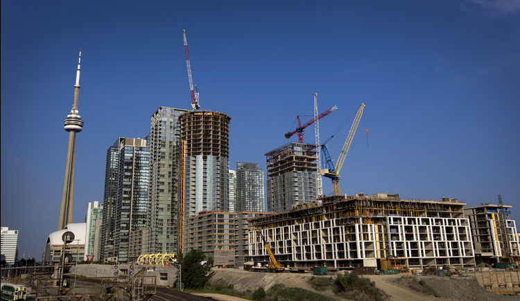 Toronto is being transformed by a wave of new condos as low interest rates and a stable economy draw investors and individual buyers to downtown projects. Photographer: Brent Lewin