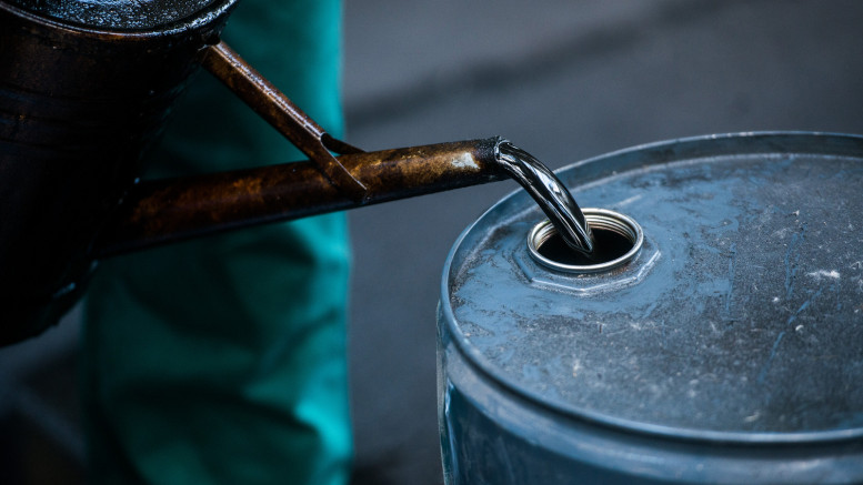 FILE PHOTO: A worker pours liquid oil into a barrel at the delayed coker unit of the Duna oil refinery operated by MOL Hungarian Oil and Gas Plc in Szazhalombatta, Hungary, on Tuesday, July 9, 2013. Photographer: Akos Stiller