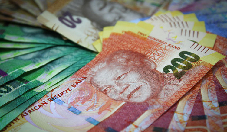 Mixed denomination rand currency banknotes are arranged for a photograph at a First National Bank (FNB) branch in Johannesburg, South Africa. Photographer: Nadine Hutton