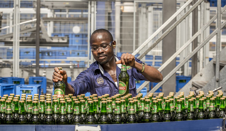 A SABMiller employee is seen working on the Hero lager bottling production line in Nigeria. Source: SABMiller Plc