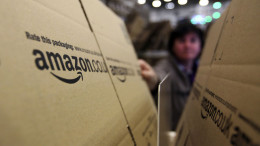 An employee selects a branded cardboard box at the Amazon.co.uk. Marston Gate 'Fulfillment Center,' the U.K. site of Amazon.com Inc., in Ridgmont, U.K. Photographer: Chris Ratcliffe