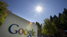 Google Inc. signage is displayed in front of the company's headquarters in Mountain View, California. Photographer: David Paul Morris