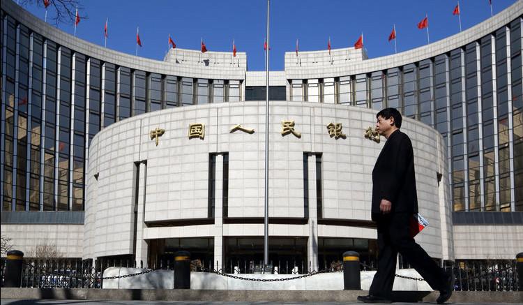 A man walks past the People's Bank of China (PBOC) headquarters in Beijing, China. Photographer: Tomohiro Ohsumi/Bloomberg