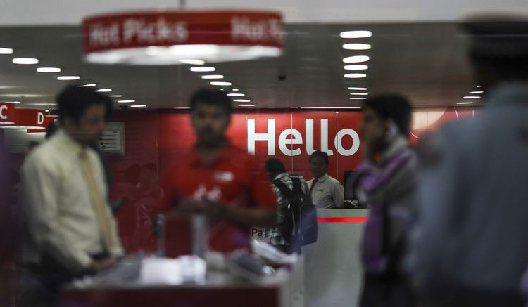 Customers stand inside a Vodafone Group Plc retail store in Mumbai, India. Photographer: Dhiraj Singh