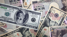Japanese yen notes and U.S. dollar notes are arranged for a photograph in Tokyo. Photographer: Tomohiro Ohsumi