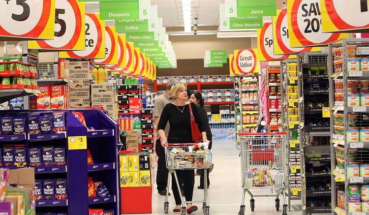 A shopper browses inside a Wesfarmers Ltd. Coles supermarket in Perth, Australia. Photographer: Sergio Dionisio