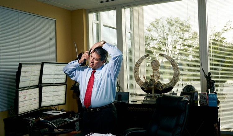 Jared Martinez, CEO of Market Traders Institute, combs his hair as he prepares to teach an all-day forex-trading seminar at MTI's school in Lake Mary, Florida. Photographer: Reed Young
