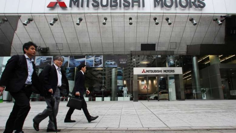 Pedestrians walk past the Mitsubishi Motors Corp. headquarters in Tokyo, Japan, on April 21, 2016. PHOTO: BLOOMBERG