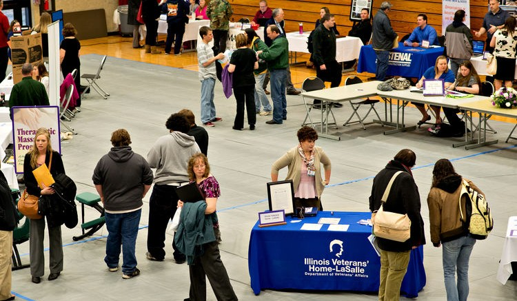 Job seekers mingle with employers during a job fair in Oglesby, Illinois. Photographer: Daniel Acker/Bloomberg