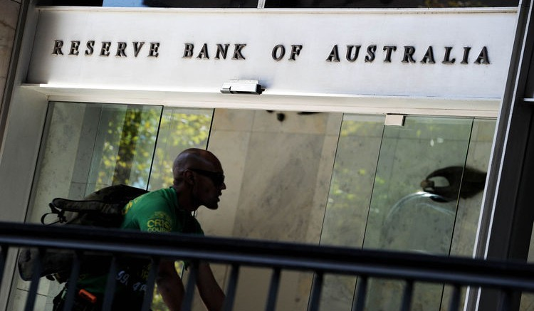 A bike courier rides past the entrance to the Reserve Bank of Australia (RBA) in Sydney's central business district on April 2, 2013. AFP PHOTO / Greg WOOD        (Photo credit should read GREG WOOD/AFP/Getty Images)