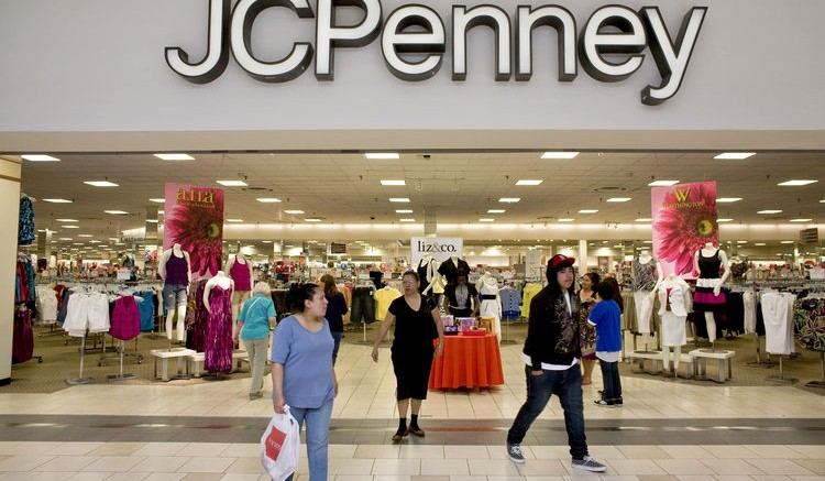 Shoppers enter and exit through the mall entrance of a J.C. Penney store at the Town Center at Aurora mall in Aurora, Colorado, U.S., on Saturday, May 9, 2009. J.C. Penney Co., the third-largest U.S. department store operator. Photographer: Matthew Staver/Bloomberg News