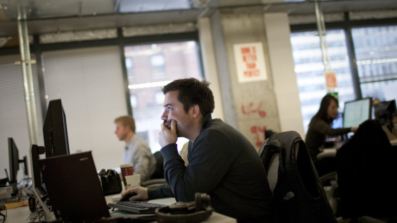 Facebook Inc. employees work at their desks at the company's office in New York, U.S., on Tuesday, Dec. 20, 2011. Photographer: Scott Eells/Bloomberg via Getty Images