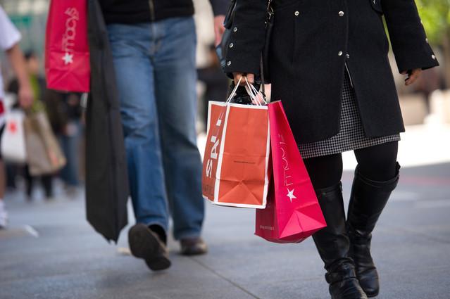 Pedestrians carry shopping bags as they shop in San Francisco, California, U.S. Photographer: David Paul Morris/