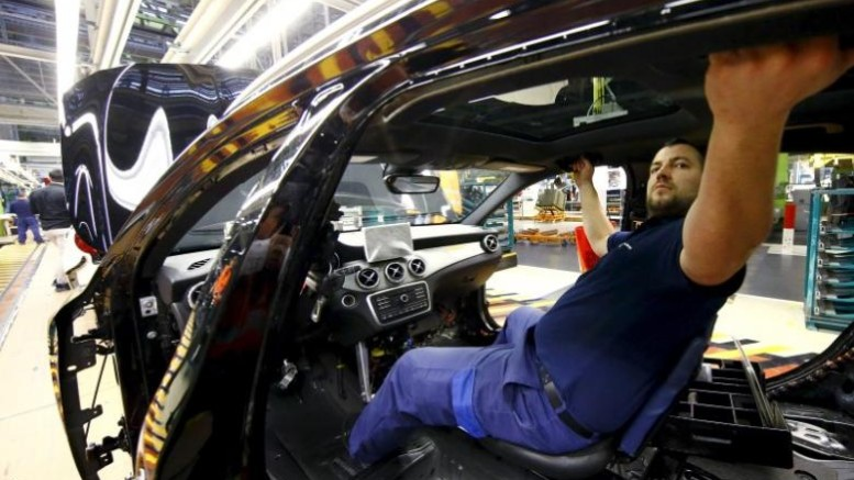 An employee of German car manufacturer Mercedes Benz works on the interior of a GLA model at their production line at the factory in Rastatt, Germany, in this January 22, 2016 file photo. REUTERS/Kai Pfaffenbach/Files