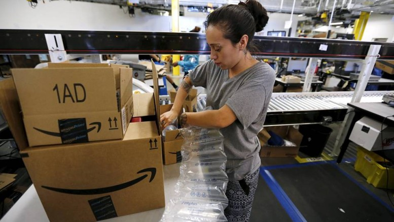 An Amazon employee prepares customers' orders at a fulfillment center in Tracy, Calif.