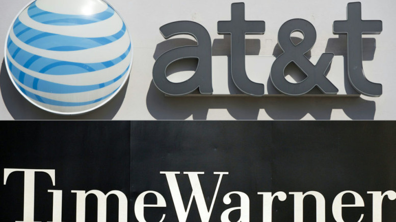 An AT&T-Time Warner  / AFP PHOTO / SAUL LOEB AND STAN HONDA