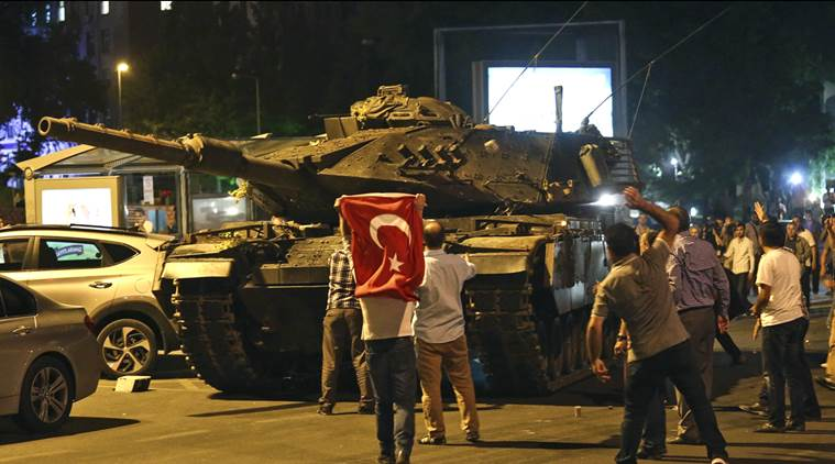 A tank moves into position as Turkish people attempt to stop them, in Ankara, Turkey, early Saturday, July 16, 2016. (AP Photo)
