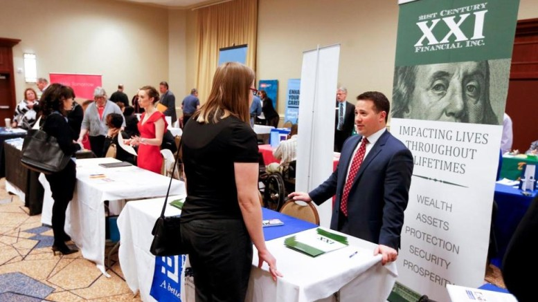 Companies speak with job seekers.
