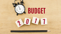 Budget 2017 year on cube with pencil and clock