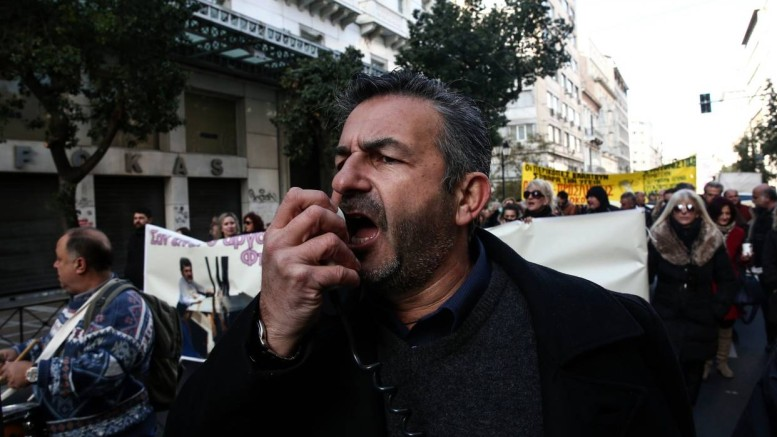A health-care worker chanted slogans during an Athens rally staged Wednesday in protest of planned overhauls required by Greece's bailout plan. PHOTO YORGOS KARAHALISASSOCIATED PRESS