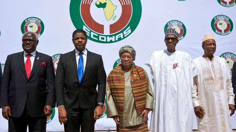 (From L) Sierra Leon's President Ernest Bai Koroma, President of ECOWAS official Marcel Alain de Souza, Liberian President and Ecowas Chairperson Ellen Johnson Sirleaf, Nigerian President Muhammadu Buhari (R) and Guinean President Alpha Conde (C) pose during the 50th summit of the 15-member Economic Community of West African States (ECOWAS) in Abuja, on December 17, 2016.