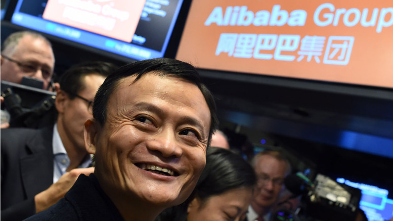 Alibaba founder Jack Ma smiling as he waits for the trading to open on the floor at the New York Stock Exchange on September 19, 2014.