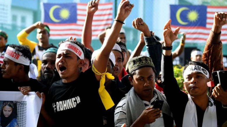 Ethnic Rohingya Muslim refugees shout slogans during a gathering in Kuala Lumpur on Dec 4, 2016 against the persecution of Rohingya Muslims in Myanmar. PHOTO: AFP