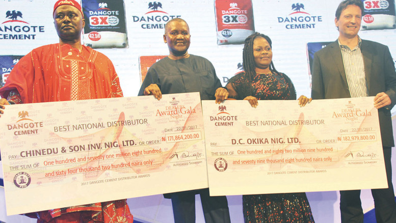 Winner of the second best national distributor and Chairman, Chinedu & Son Inv. Nig Limited, Ide Chinedu Ezenyili (left); Chairman, Dangote Cement Plc, Aliko Dangote; best national distributor and Managing Director, D. C. Okika Nig Ltd., Beatrice Okika and Group Managing Director of the firm, Onne van der Weijde, during the gala night & award ceremony for Dangote cement distributors in Lagos.