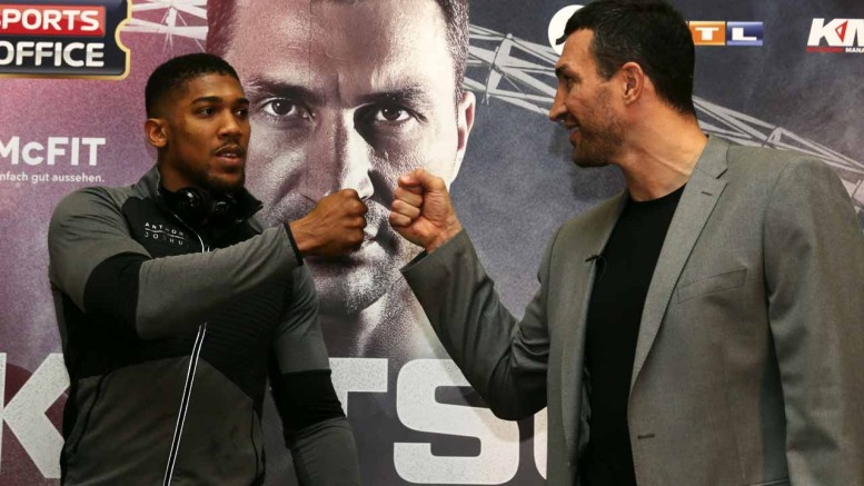 Britain's Anthony Joshua (L) and Ukraine's Wladimir Klitschko (R) take part in a press conference at Wembley Stadium in north west London on December 14, 2016