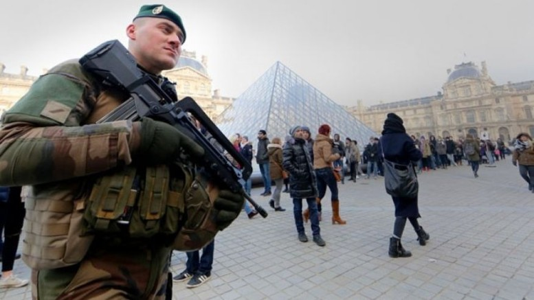 An armed French soldier patrols at the Louvre Museum.