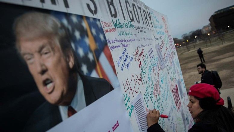WASHINGTON, DC – FEBRUARY 3: Protestors write 'messages of resistance' to President Donald Trump and his executive orders on a wall near the Washington Monument, February 3, 2017 in Washington, DC. The protest is aimed at President Trump's travel ban policy. Drew Angerer/Getty Images/AFP