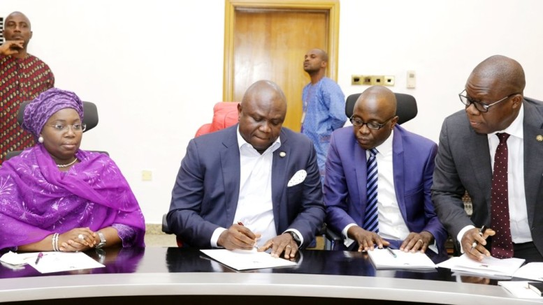 Lagos State Governor Akinwunmi Ambode (2nd left); Deputy Governor, Mrs. Oluranti Adebule (left); Commissioner for Finance/Economic Planning and Budget, Mr. Adeyemi Ashade (2nd right); and Attorney General and Commissioner for Justice, Mr. Adeniji Kazeem during the signing of N47 billion bond deal with issuing houses at the Banquet Hall, Lagos House, Ikeja