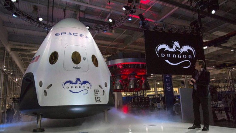 SpaceX CEO Elon Musk (R) unveils the Dragon V2 spacecraft in Hawthorne, California, on May 29 in 2014