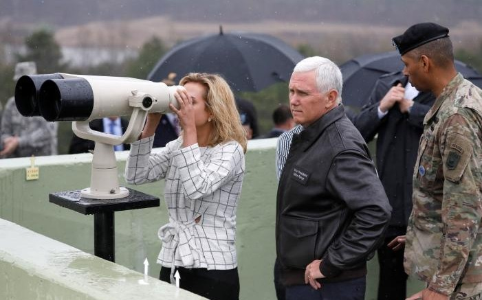 U.S. Vice President Mike Pence stands next to her daughter looking toward the north through a pair of binocular from an observation post inside the demilitarized zone separating the two Koreas, in Paju, South Korea, April 17, 2017.  REUTERS/Kim Hong-Ji