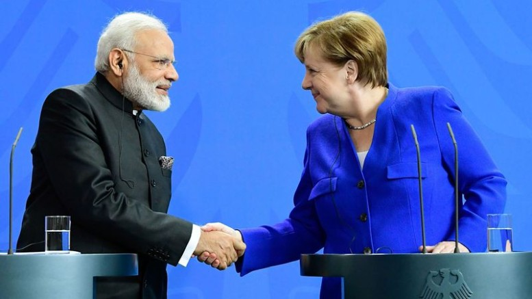 Narendra Modi and Angela Merkel on May 30.Photographer: Tobias Schwarz/AFP/Getty Images