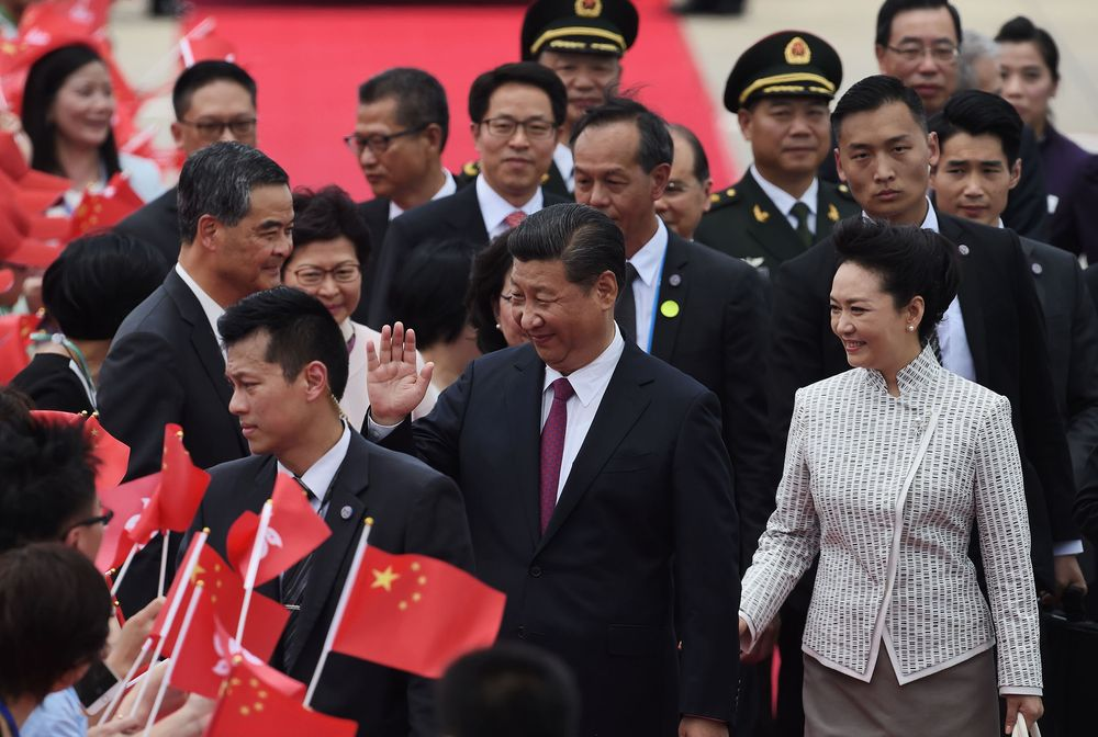 China's President Xi Jinping and his wife Peng Liyuan arrive in Hong Kong on June 29. Photographer: Anthony Wallace/AFP via Getty Images