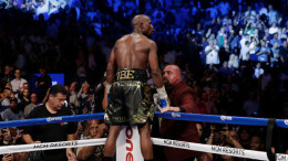 Floyd Mayweather Jr. celebrating his victory over Conor McGregor. Credit Isaac Brekken/Associated Press