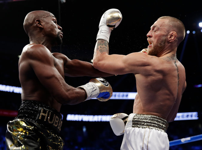 Floyd Mayweather Jr., left, and Conor McGregor during a match Saturday in Las Vegas. Credit Isaac Brekken/Associated Press
