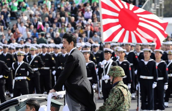 Prime Minister Shinzo Abe during Japan Self-Defense Forces Day last year at Camp Asaka, northwest of Tokyo. Credit Eugene Hoshiko/Associated Press