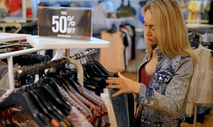 A shopper looks at clothes on sale in a retail store in central Sydney, Australia, November 28, 2016. Steven Saphore