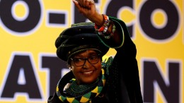 Winnie Madikizela Mandela, ex-wife of former South African president Nelson Mandela, gestures to supporters at the 54th National Conference of the ruling African National Congress (ANC) at the Nasrec Expo Centre in Johannesburg, South Africa December 16, 2017. REUTERS/Siphiwe Sibeko/File Photo