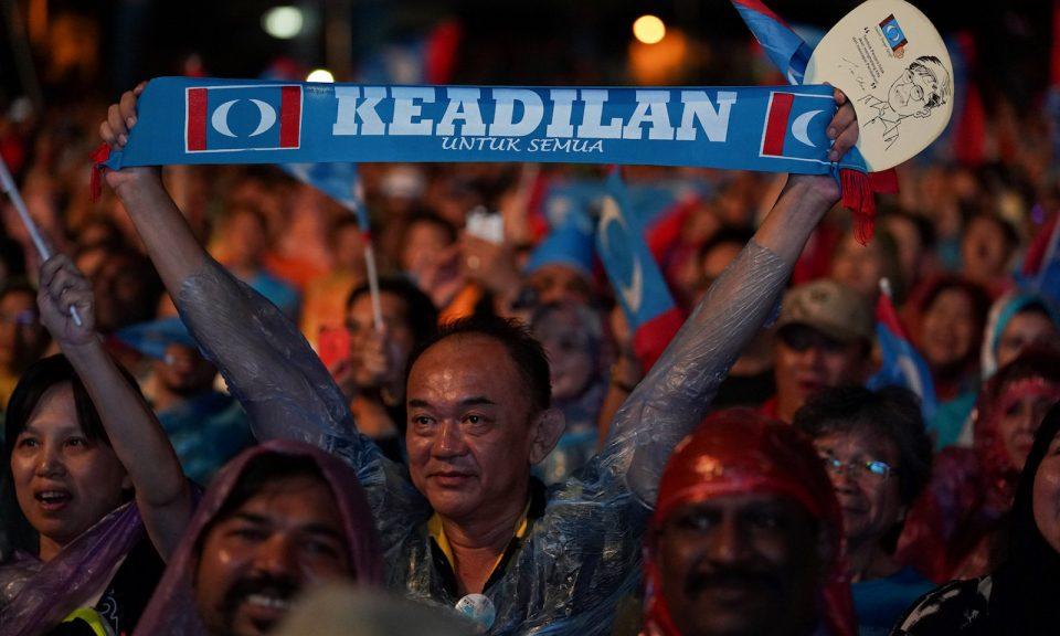 Malaysians celebrating the historic victory.