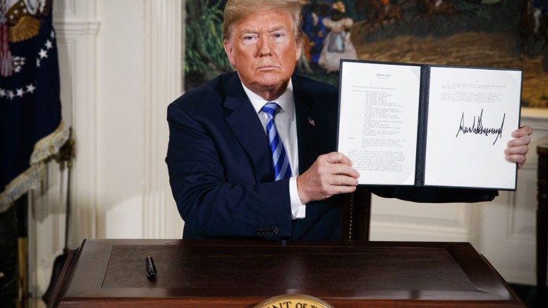 President Trump shows a signed presidential memorandum reinstating US nuclear sanctions on the Iranian regime on May 8, 2018