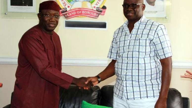 Fayemi in a handshake with Fayose.