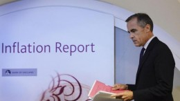 Bank of England Governor Mark Carney arrives to present the bank's quarterly inflation report news conference at the Bank of England in London