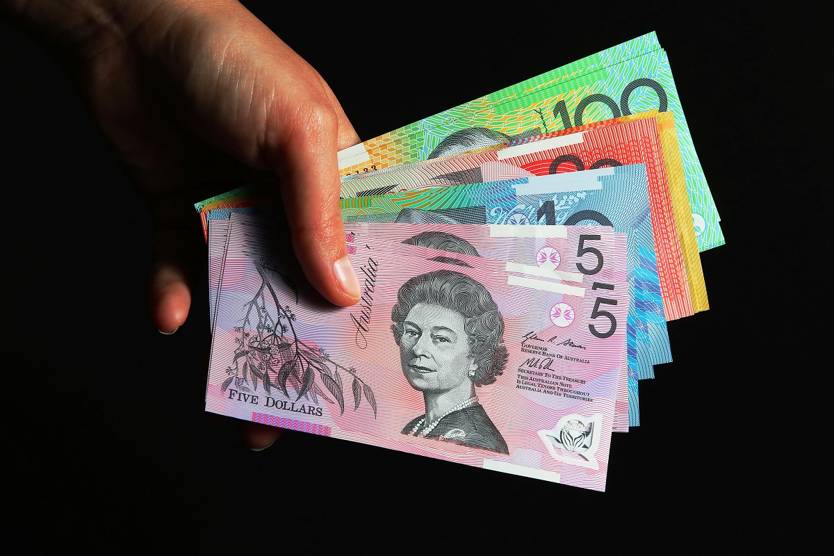 Dollar dumped on rate outlook, Aussie looks to RBA